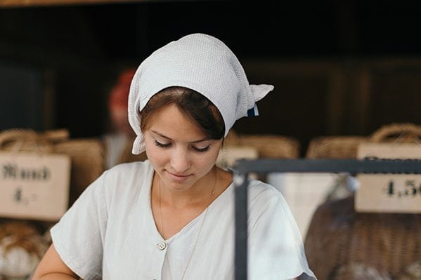 woman with protecet hairscarfat work in the bakery